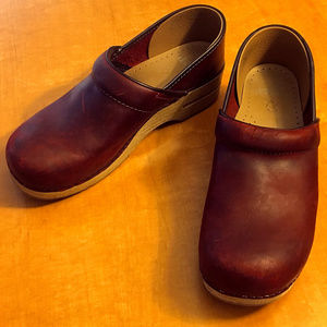 Dansko oiled red clogs